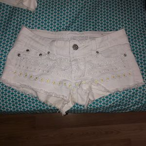 Embroidered white jean shorts